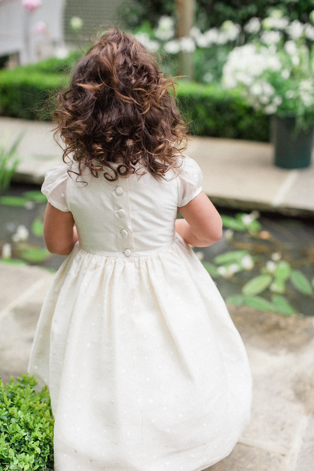 flower girl dress - photo by Roberta Facchini Photography http://ruffledblog.com/herbarium-inspired-wedding-ideas