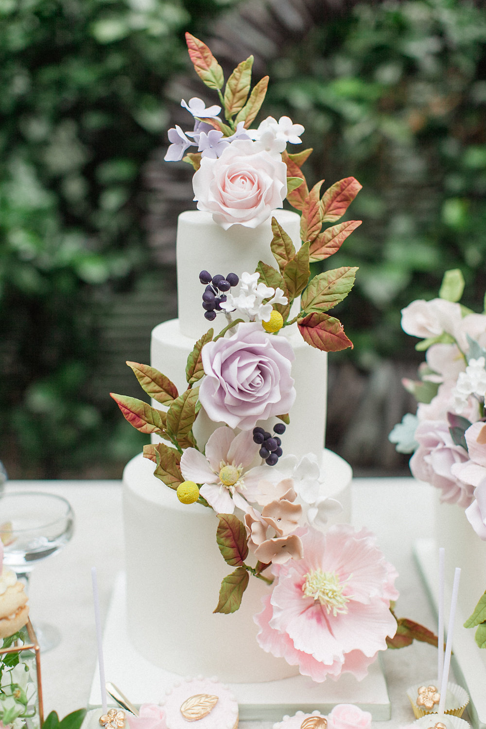 wedding cake with sugar flowers - photo by Roberta Facchini Photography http://ruffledblog.com/herbarium-inspired-wedding-ideas