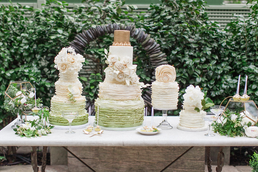 green and gold cake table - photo by Roberta Facchini Photography http://ruffledblog.com/herbarium-inspired-wedding-ideas
