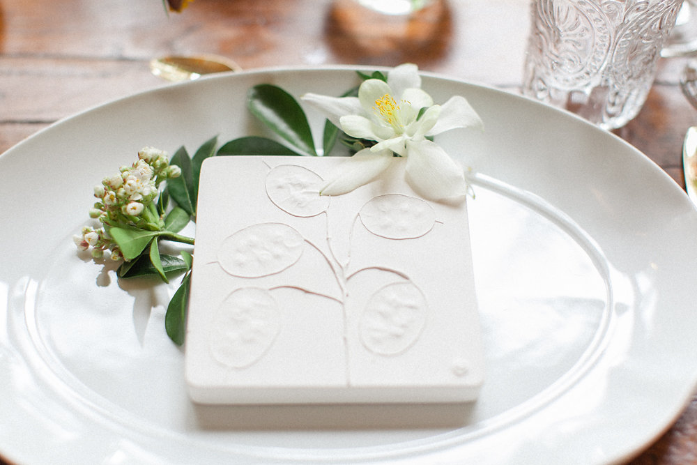 tile wedding favors - photo by Roberta Facchini Photography http://ruffledblog.com/herbarium-inspired-wedding-ideas
