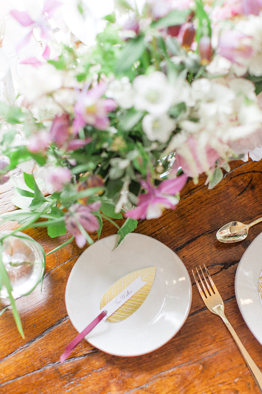 place settings with place cards - photo by Roberta Facchini Photography http://ruffledblog.com/herbarium-inspired-wedding-ideas