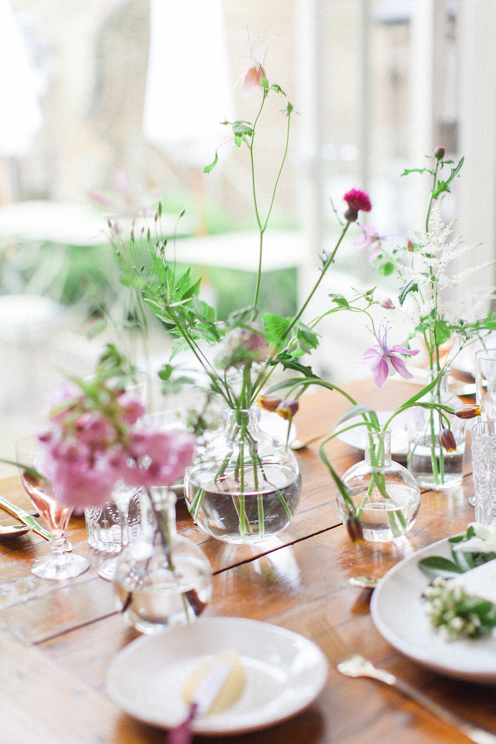 wildflower centerpieces - photo by Roberta Facchini Photography http://ruffledblog.com/herbarium-inspired-wedding-ideas