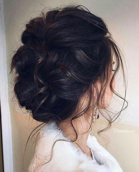 braided updo with tiny locks all over