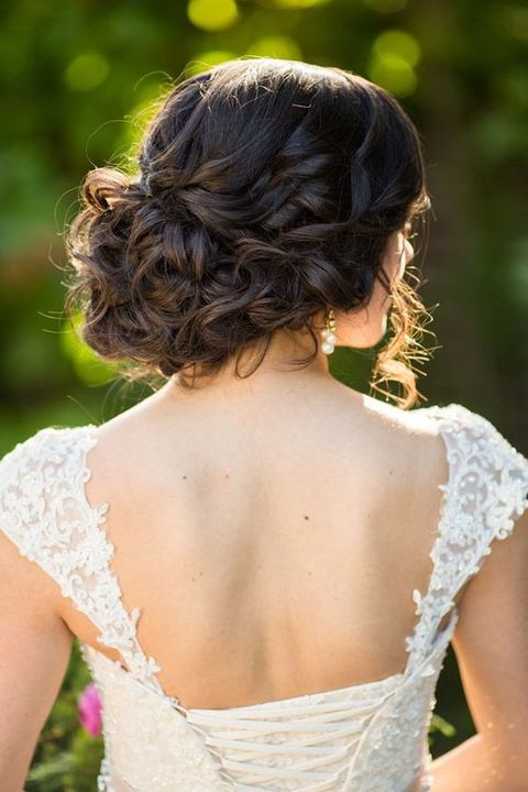 elegant messy updo with no accessories looks chic
