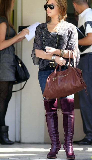 With blouse, jeans and brown bag
