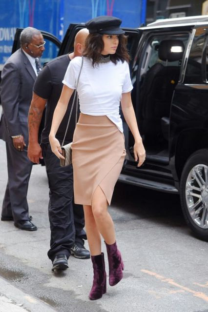 With white t-shirt, beige skirt and mini bag