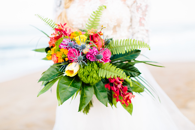 The wedding bouquet echoed with the centerpiece, it was done in bold flowers