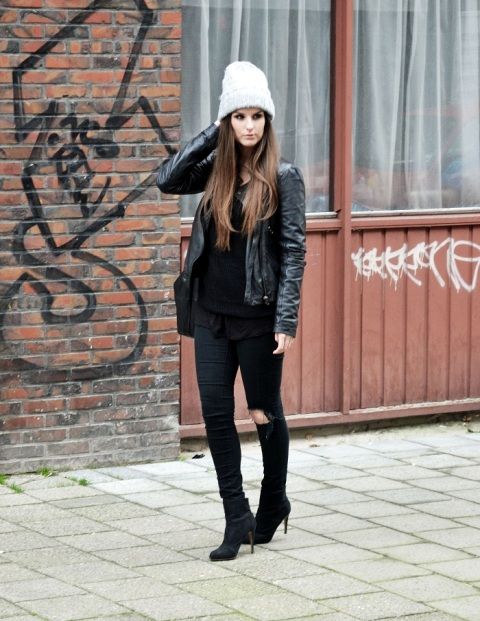 With leather jacket, black shirt, jeans and boots