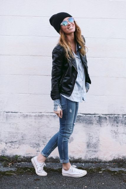 With leather jacket, shirt, cuffed jeans and white sneakers