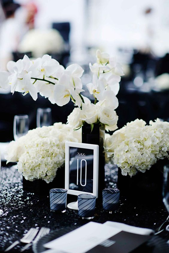 black and white framed table numbers look awesome in this table setting