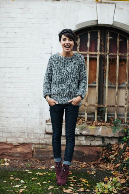 With gray sweater and cuffed jeans
