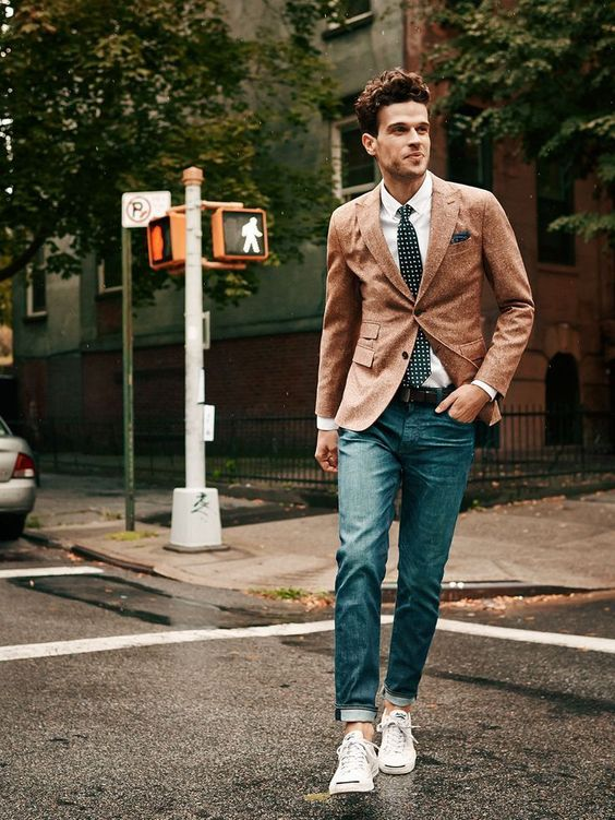 blue jeans, an ocher jacket and white sneakers