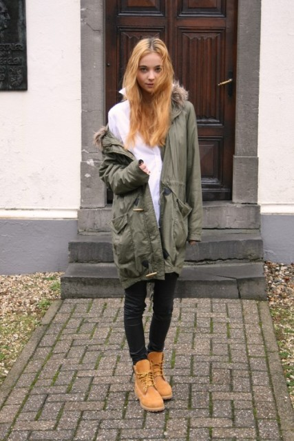 With classic shirt, pants and green army coat