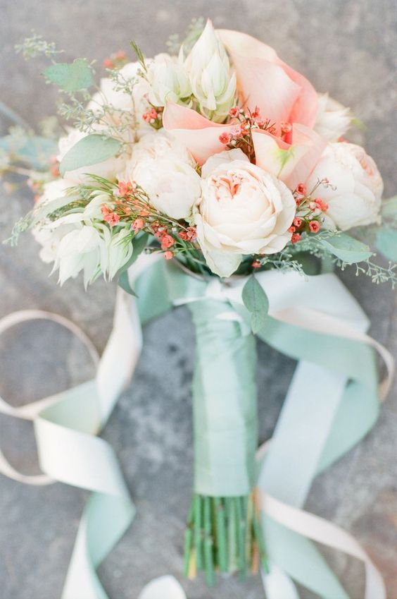 peach and blush bouquet with a mint wrap