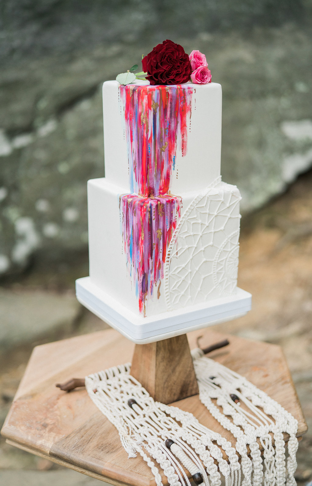 colorful wedding cake - http://ruffledblog.com/nomadic-cliffside-elopement-inspiration