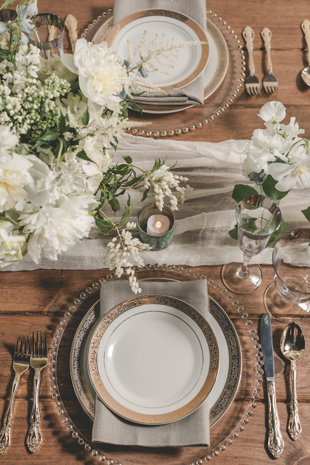 Stylish farm table wedding reception place setting | About Time Photography