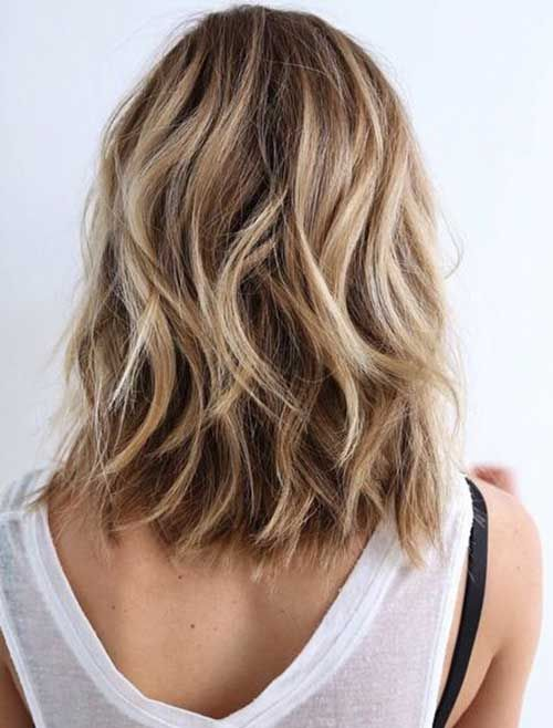 wavy bob with shades of blonde and light brown for a natural look