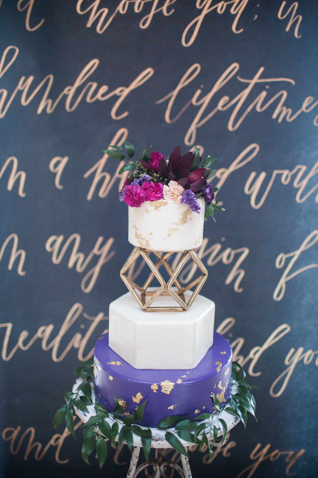 geo wedding cake - photo by Elizabeth Marie Photos http://ruffledblog.com/gold-and-plum-wedding-inspiration-with-hayley-paige-gown
