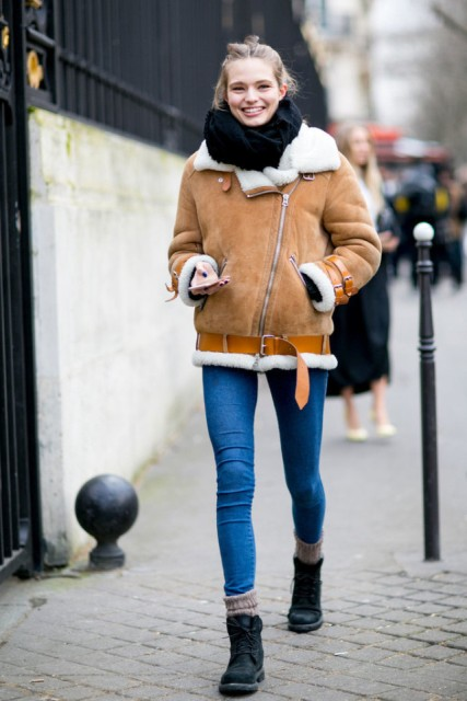 With skinny jeans, oversized scarf and ankle boots with socks