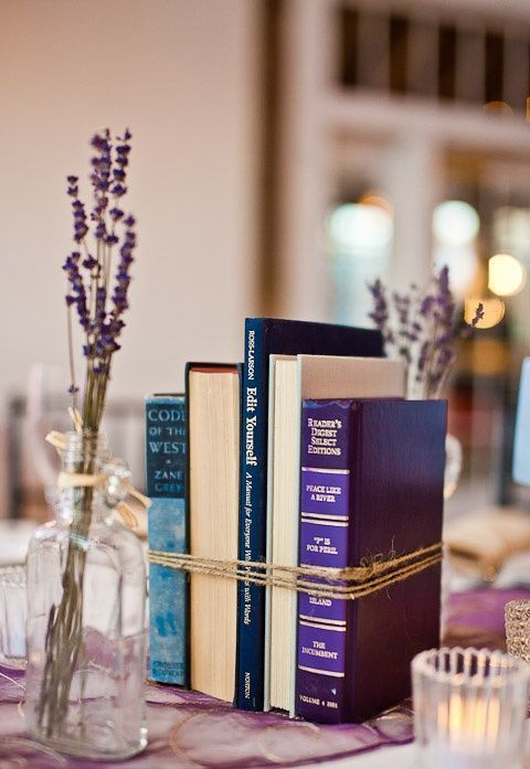 bundled book centerpiece with lavender