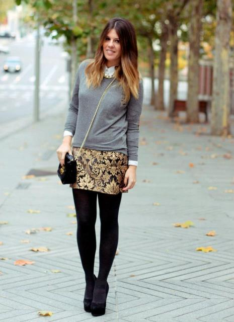 With gray shirt, black tights, pumps and chain strap bag