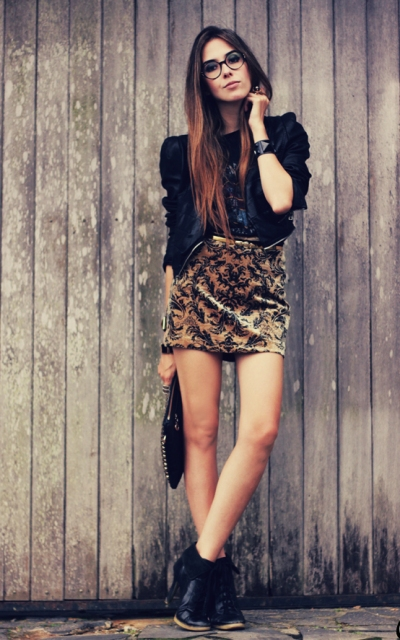 With printed blouse, leather jacket and black ankle boots