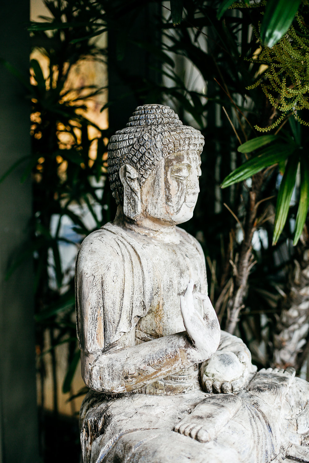 Buddha statue - photo by Lara Hotz http://ruffledblog.com/secret-garden-inspired-australian-wedding