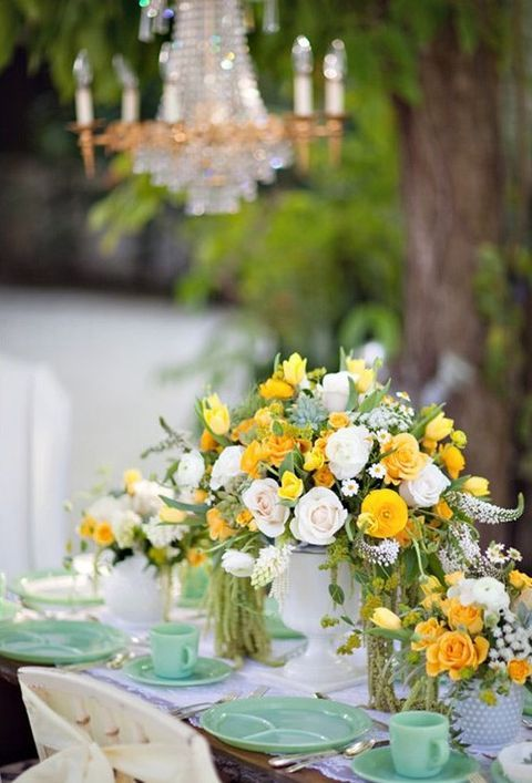 mint dishes and cups, yellow and ivory flowers for centerpieces