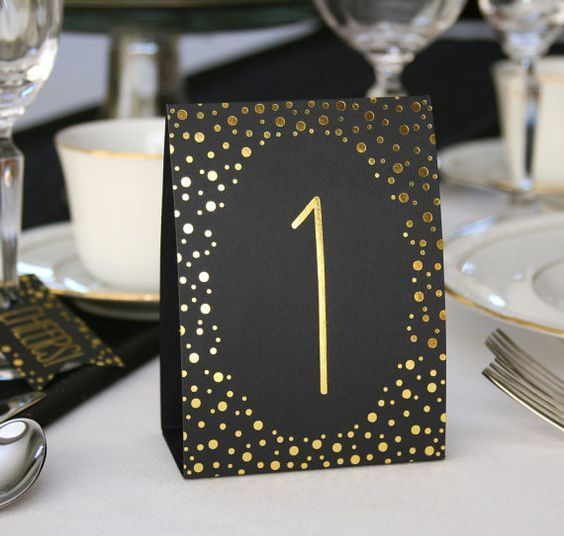 gold and black tented table cards with numbers