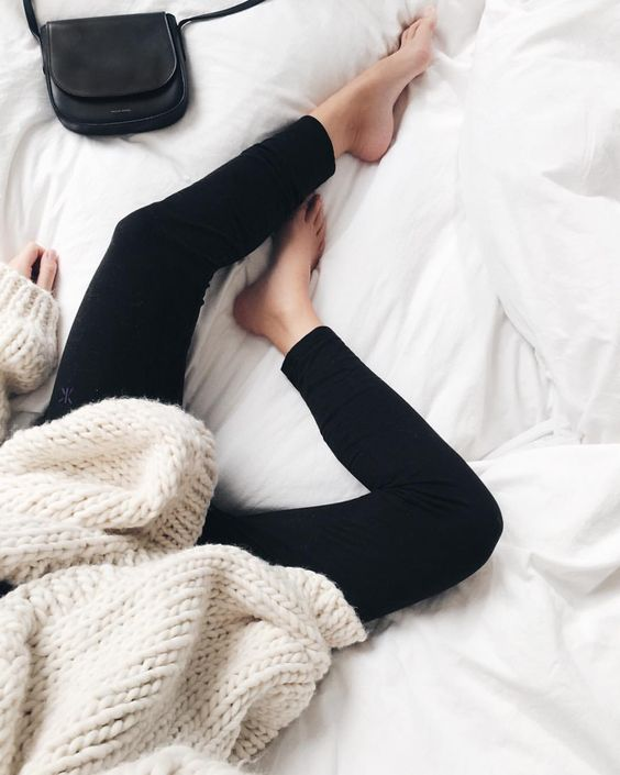 black leggings and a chunky knit white sweater for cold seasons