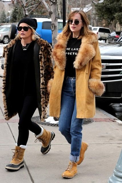 With fur coat and cuffed jeans