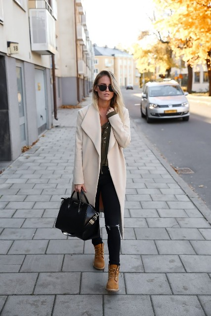 With jeans and pastel color midi coat