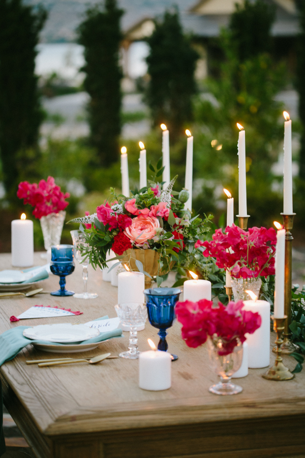Candles and bold florals created a mood and made the table settign vibrant