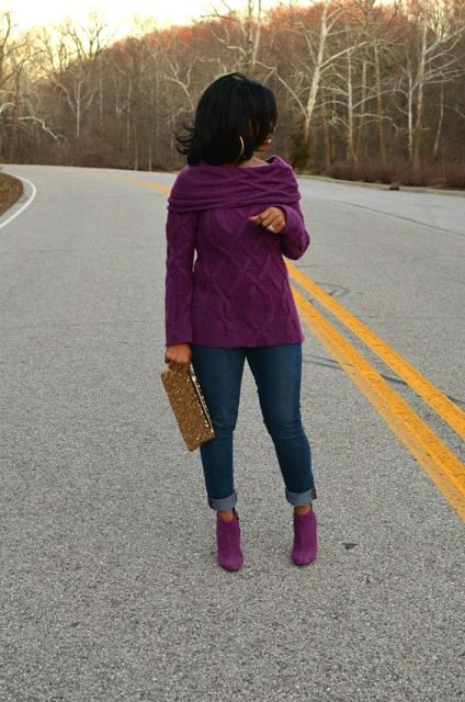 With purple sweater, cuffed jeans and eye-catching clutch