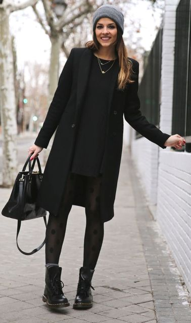 With mini black dress, printed tights, mid calf boots and black knee-length coat