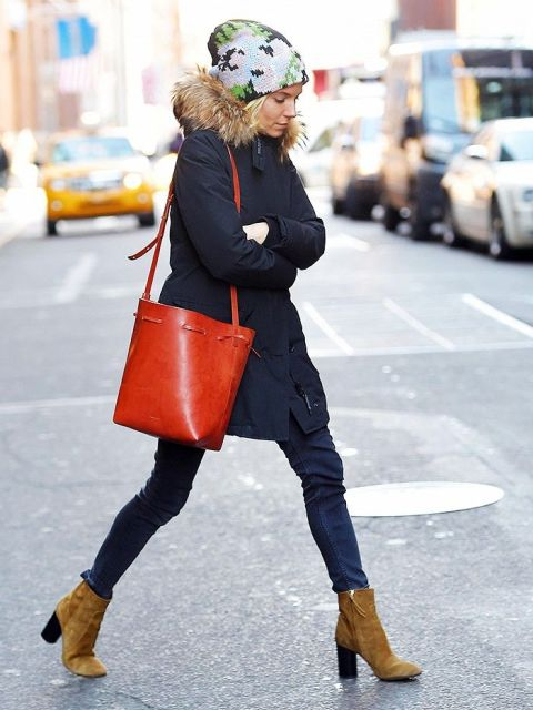 With mini coat, jeans, brown ankle boots and red bag