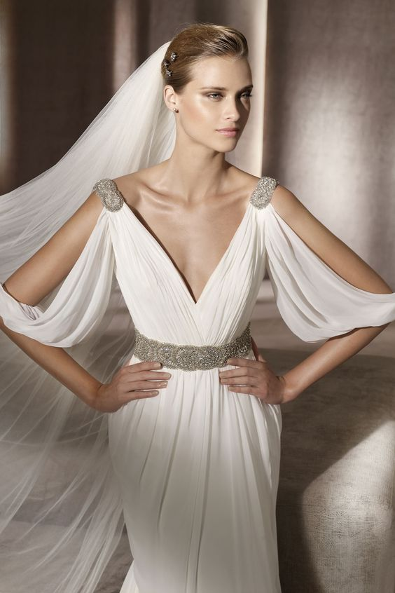 draped wedding gown with cutout sleeves, embellished shoulders and a belt