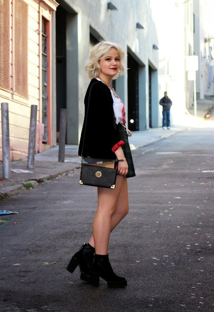 With skater skirt, black blazer and crossbody bag