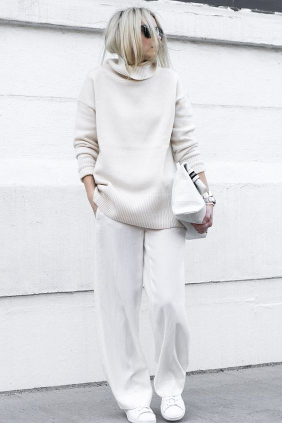 an oversized white turtleneck sweater and pants to feel comfy