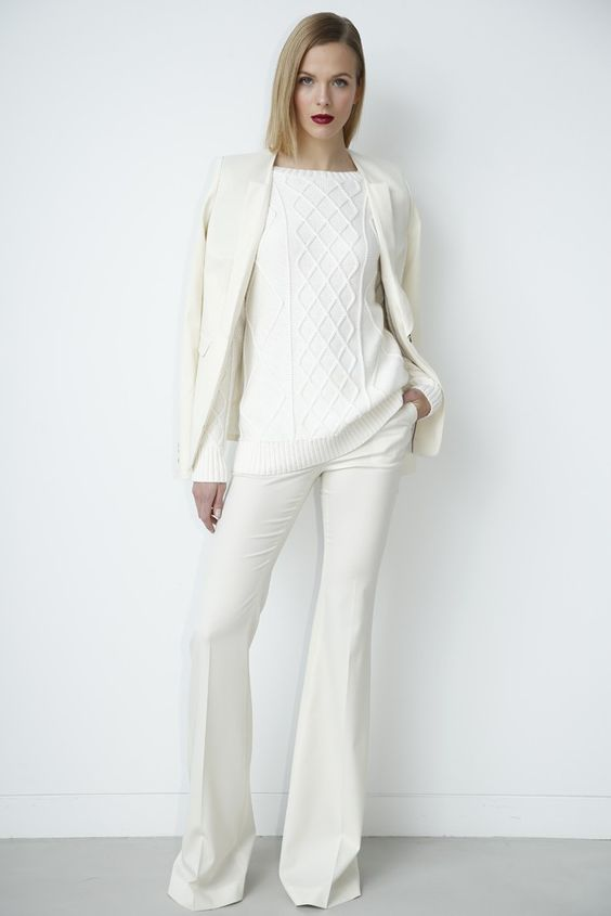 white pants and a sweater, an ivory jacket