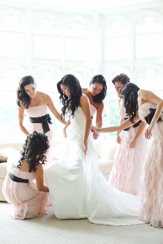 blush ruffled dresses with black sashes and bows