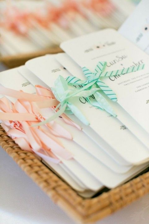 add peach and mint ribbon to each program or menu