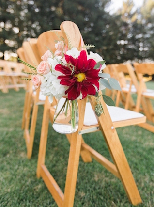 Hanging mason jars with flowers for wedding ceremony chairs | Love in Photographs