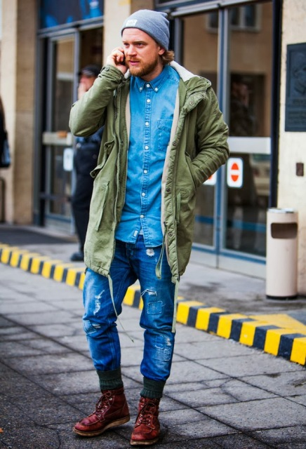 With denim shirt, distressed jeans and marsala boots