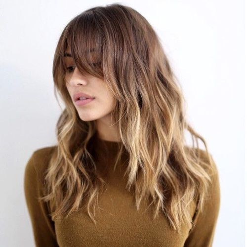 off-center bangs, long layers and pretty, loose waves