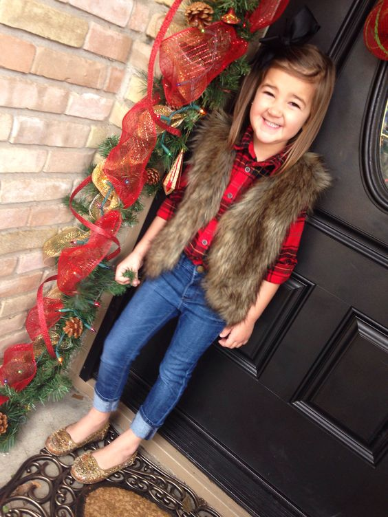 a plaid shirt, cuffed jeans, glitter flats and a faux fur vest