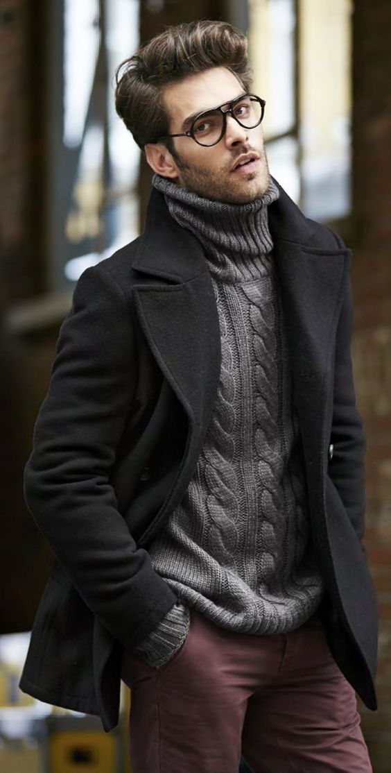 purple velvet pants, a grey cable knit sweater and a black coat