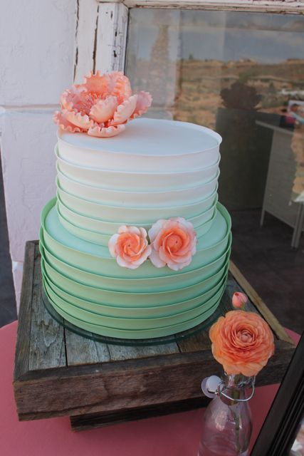 ombre mint wedding cake with peach-colored flowers