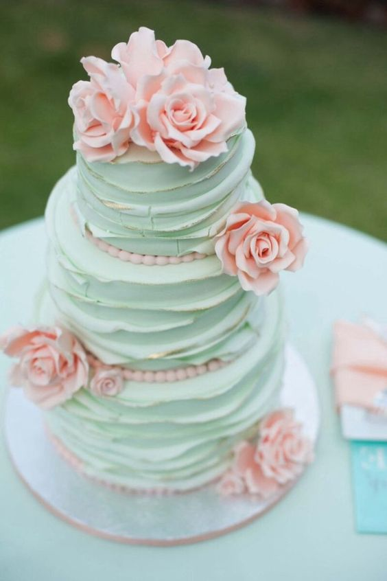 mint ruffle cake with peach sugar roses