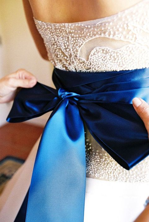 royal blue sash and a large bow